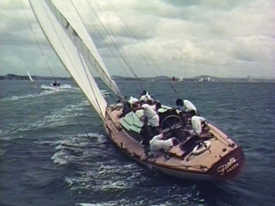 Spindrift - Auckland is known as the City of Sails and each Anniversary Day, the Waitemata Harbour hosts the world's largest one-day regatta. The culture of yachting on the Hauraki Gulf gets full-blown homage in this 1968 National Film Unit film. The short documentary sets up sailing as a way to esc...